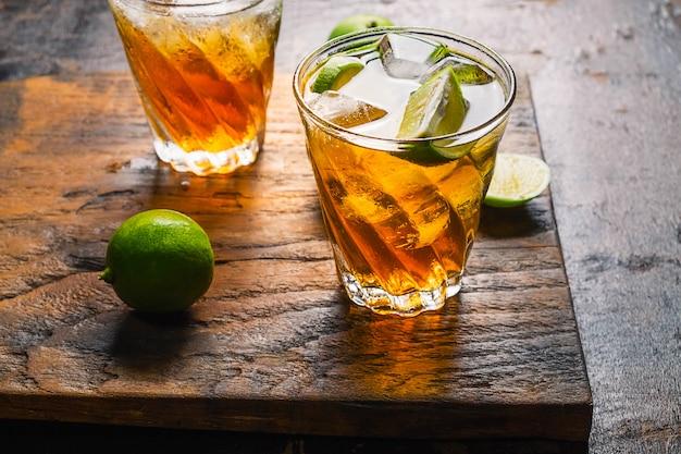 Iced lemon tea and lemon on a wooden table