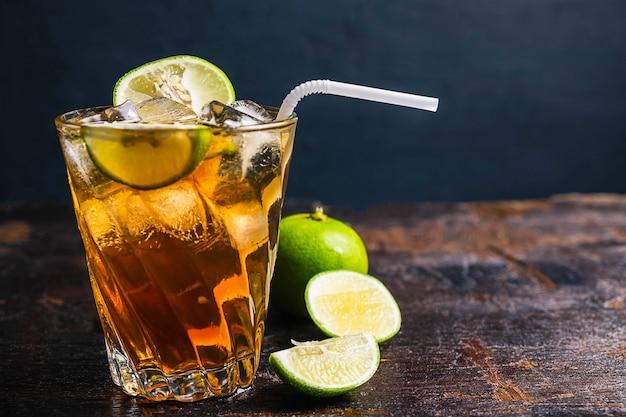 Iced lemon tea and lemon on wooden table