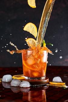 Iced lemon tea in motion concept.