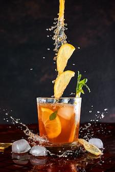 Iced lemon tea in motion .