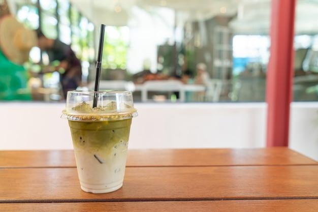 Iced matcha green tea milkshake in coffee shop cafe restaurant
