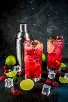 Iced summer drink cocktail, raspberry and lime lemonade with fresh mint and lime
