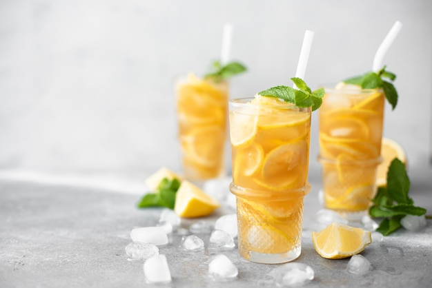 Iced tea with lemon and ginger in glasses