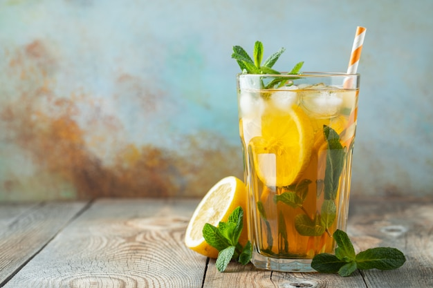 Iced tea with lemon and ice in tall glasses.