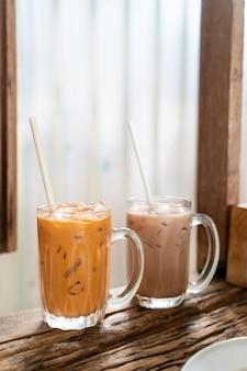 Iced thai milk tea glass in cafe restaurant