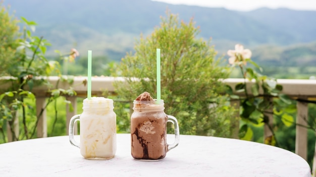 Iced white chocolate and iced chocolate in a cafe.