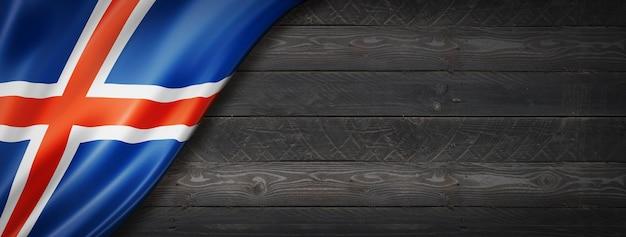 Iceland flag on black wood wall. horizontal panoramic banner.