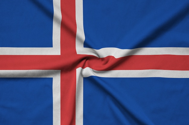 Iceland flag  is depicted on a sports cloth fabric with many folds.