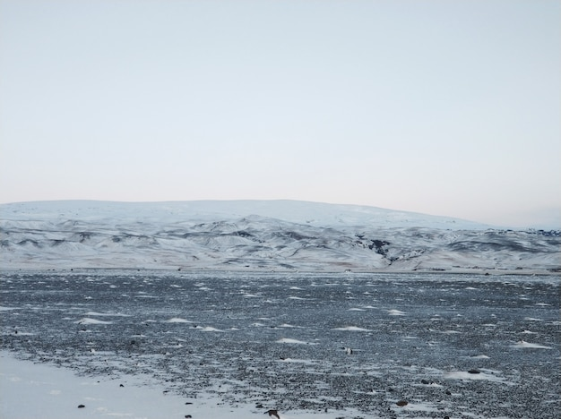 Iceland's incredible fields and plains landscape in winter. the ground is covered with snow. large spaces. the beauty of winter nature.