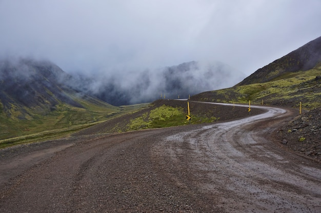 Icelandic gravel road in typical icelandic misty weather.