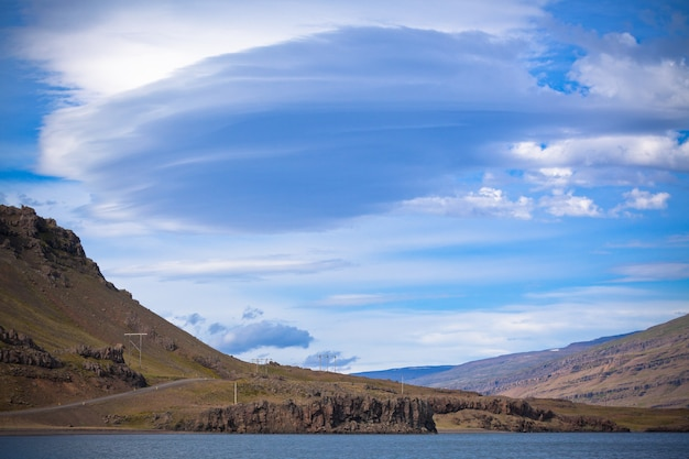 Icelandic mountain landscape under a blue summer sky