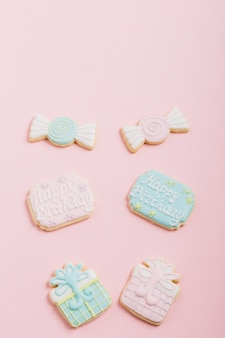 Icing cookies in chocolate; gift box shape on pink background