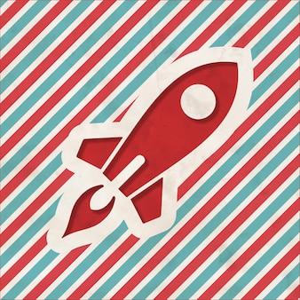 빨간색과 파란색 줄무늬 배경에 로켓 이동의 아이콘입니다. 평면 디자인의 빈티지 개념입니다.