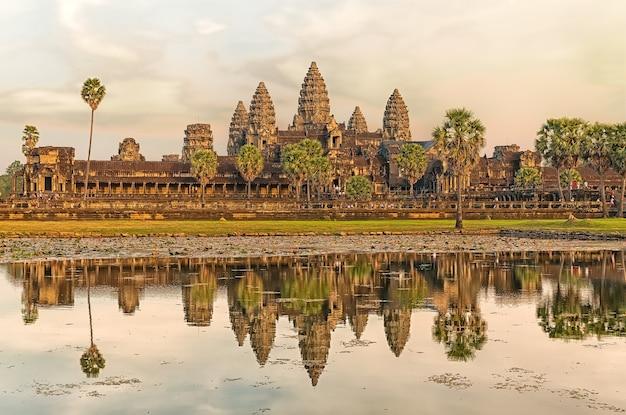 Iconic angkor wat reflecting in lake, siem reap, cambodia.