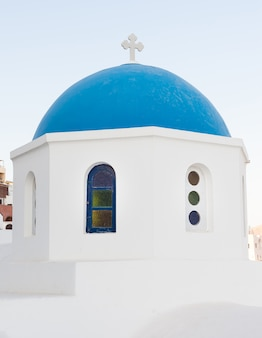 Iconic church with blue cupola in oia