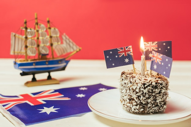 Iconic traditional australian party food lamington cakes on a red white and blue background australia flag