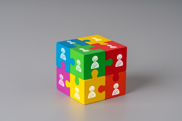 Icons on a colorful jigsaw puzzle cube