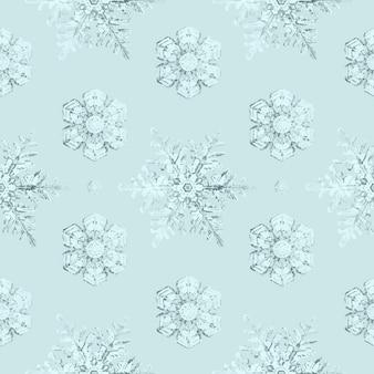 ウィルソンベントレーによる写真の氷のような雪の結晶のシームレスなパターンの背景のリミックス