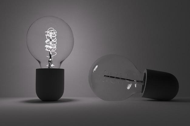 Идея концепция лампочки в сером фоне