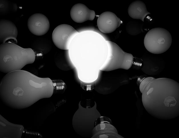 Идея концепции. одна светящаяся лампочка стоит перед блоком на черном фоне