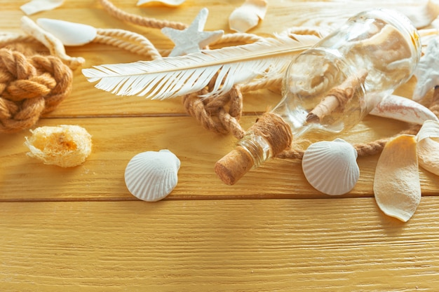 Idea of interior decoration with seashells and glass bottle