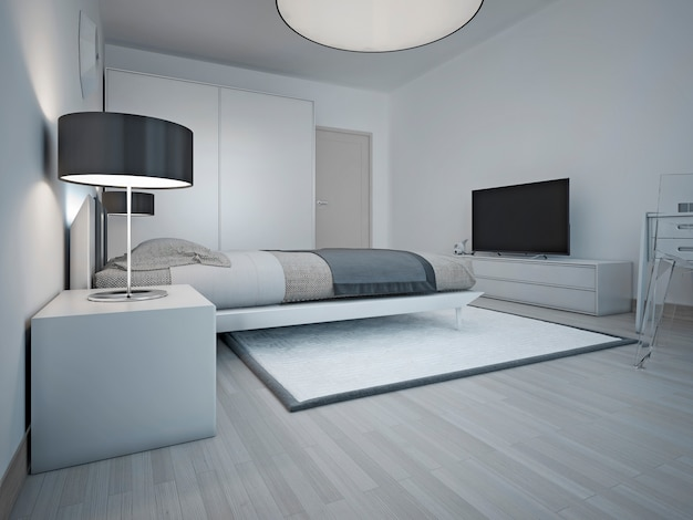 회색 벽과 크고 부드러운 침대, 검은 그늘 램프가있는 엄격한 침대 옆 탁자가있는 넓고 현대적인 침실의 아이디어.
