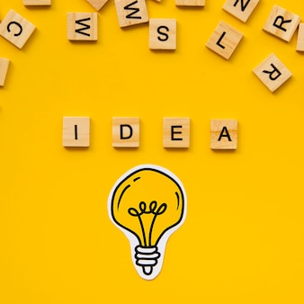 Idea word from scrabble letters and light bulb