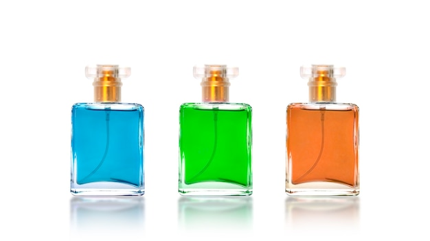 Ideas for beauty products. multi colored perfume bottles isolated on white background.