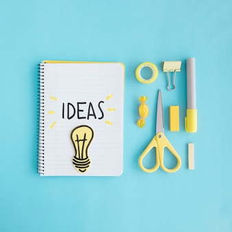 Ideas light bulb with stationary on blue background