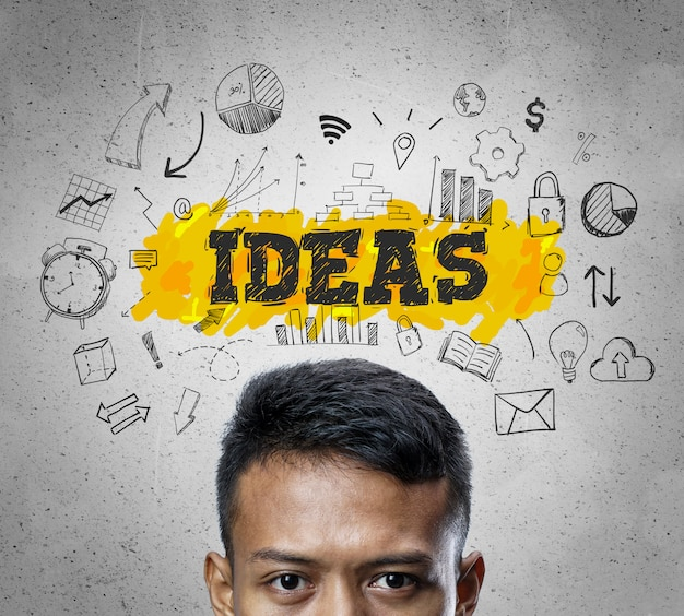Ideas text. head of asian businessman thinking business sketch concept background.