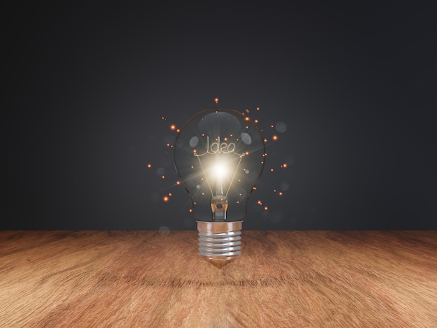 Ideas that iluminate with light bulb on wood table top