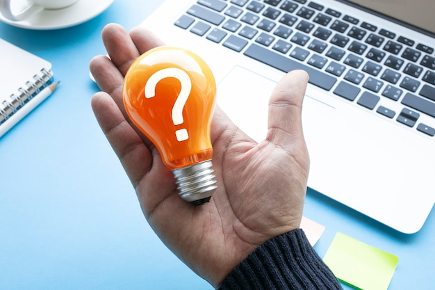 Ideas with question mark on lightbulb.business solution.