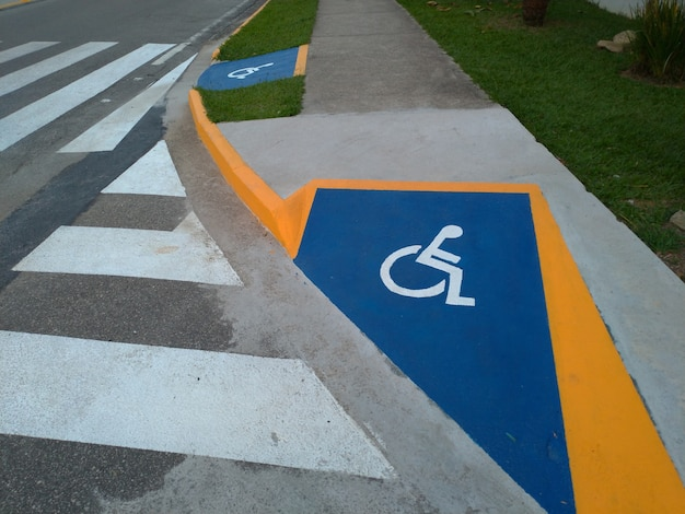 Identification wheelchair access ramp and crosswalk.