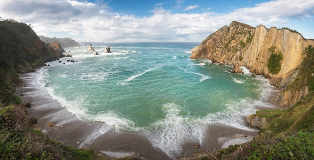 Idyllic coastline panorama landscape in cantabric sea, playa del silencio, asturias, spain.