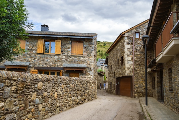Idyllic street with buildings with stone walls in llivia catalonia spain