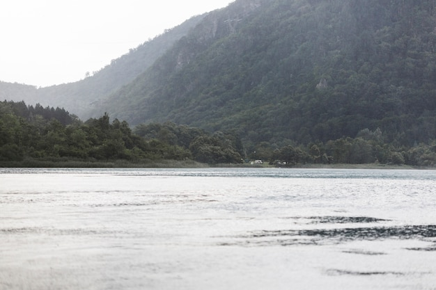 Idyllic view of lake near the green mountain