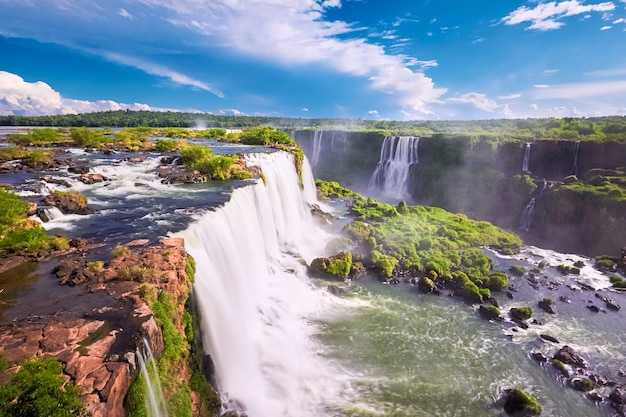 Iguazu waterfalls in argentina, view from devil's mouth. panoramic view of many majestic powerful water cascades with mist.
