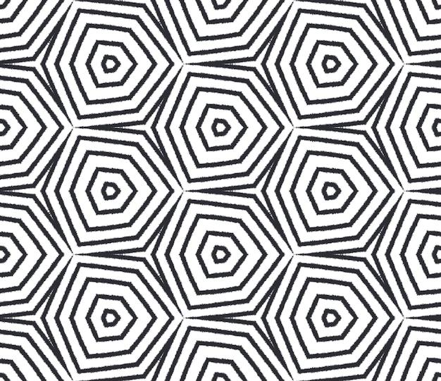 Икат повторяющийся дизайн купальников. черный симметричный фон калейдоскопа. выкройка летней спортивной одежды икат. текстиль готов с фантастическим принтом, ткань для купальников, обои, упаковка.
