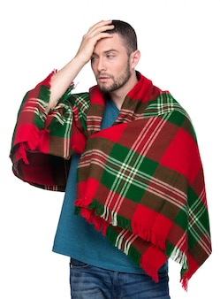 Ill man is covered with plaid blanket