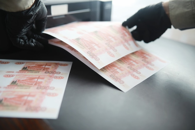 Illegal production of money the inscription on the bill five thousand rubles print money at home