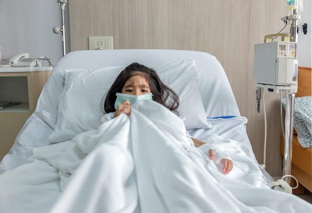Illness asian kid on hospital bed in pandemic coronavirus