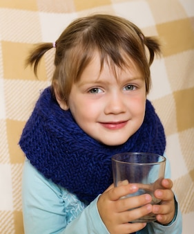 Illness baby girl in warm scarf