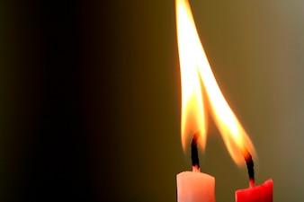 Illuminated candles, close-up