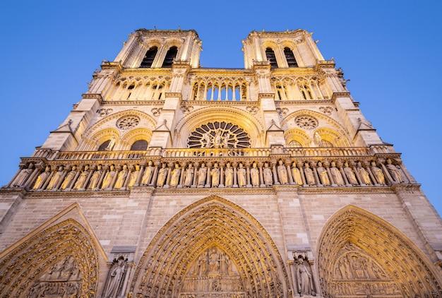 Illuminated facade of notre dame de paris cathedral