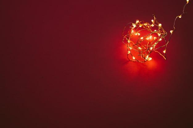 Illuminated garland lights on bright pink