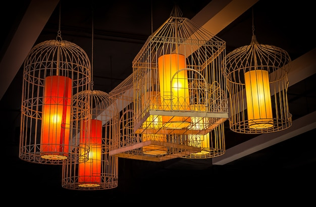 Illuminated intricate hanging lamp in birdcage style