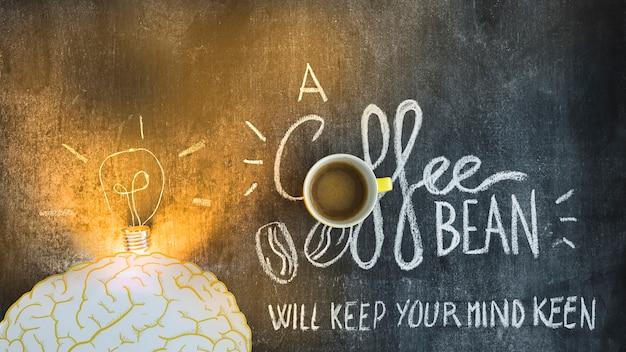 Illuminated light bulb over the brain with text on blackboard