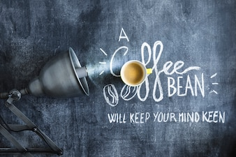 Illuminated light bulb over the coffee cup and text on blackboard