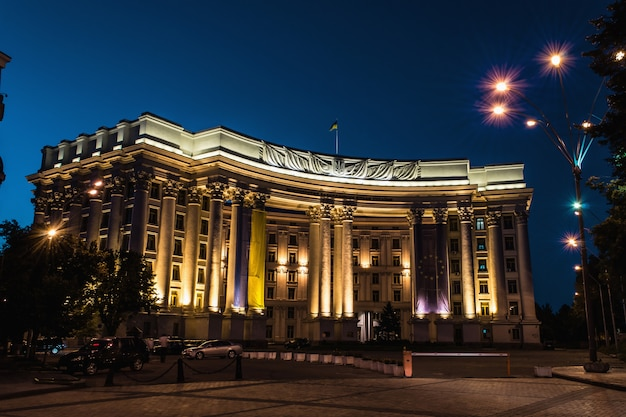 Illuminated ministry of foreign affairs of ukraine at night next to blue sky