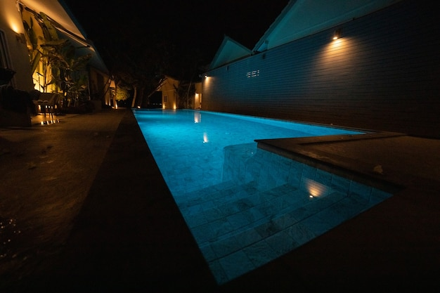 Illuminated pool in the dark at night.